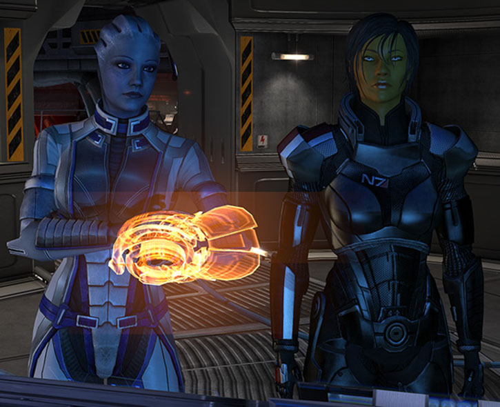 Commander Shepard (Mass Effect 3) next to Liara using her omni-tool