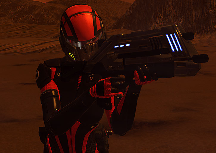 Commander Shepard aims her rifle while on an alien world