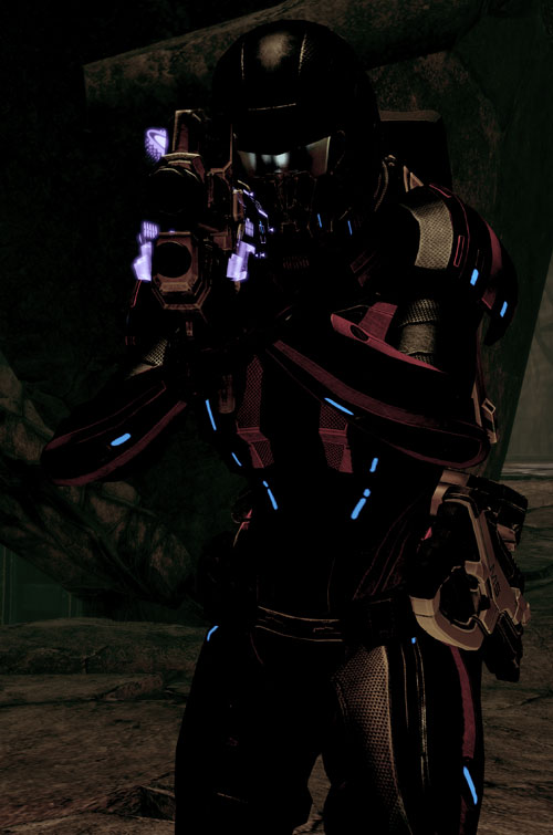 Commander Shepard (Mass Effect 2 late) full armor in darkness aiming a BFG