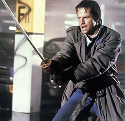 Connor McLeod the Highlander (Christopher Lambert) with his katana
