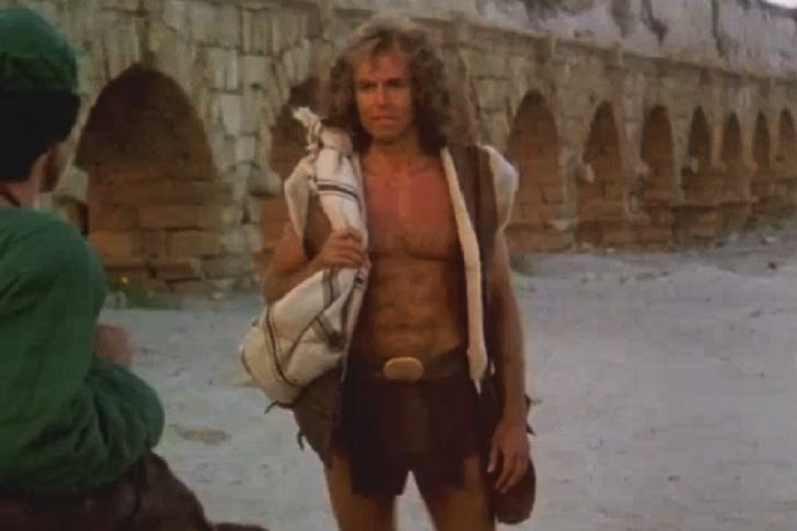 Cord (Jeff Cooper in the The Iron Circle movie) near an aqueduct