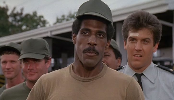 Corporal Jackson (Steve James) and other Army men