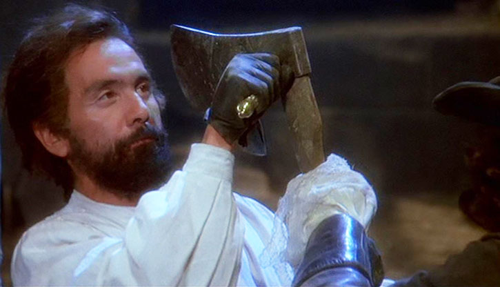 Lucian Corsican (Tommy Chong) parries a axe