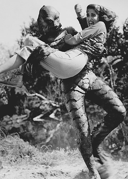 The Creature from the Black Lagoon kidnapping a woman