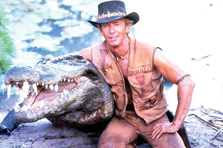 Crocodile Dundee (Paul Hogan) and a friendly neighborhood reptile