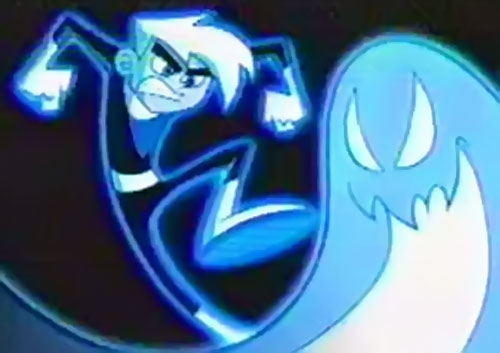 Danny Phantom Stomping On A Blue Pac Man Style Ghost Adrtismnt Posing Defiantly