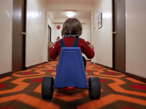 Danny Torrance (The Shining) on his bike in the corridor 2/2