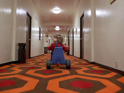 Danny Torrance (The Shining) on his bike in the corridor 1/2