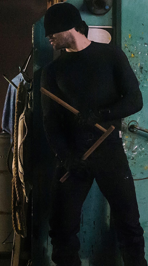 Daredevil (Charlie Cox on Netflix) with paired wooden sticks
