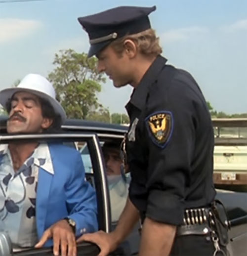 Dave Speed (Terrence Hill in Superfuzz) in a black police uniform