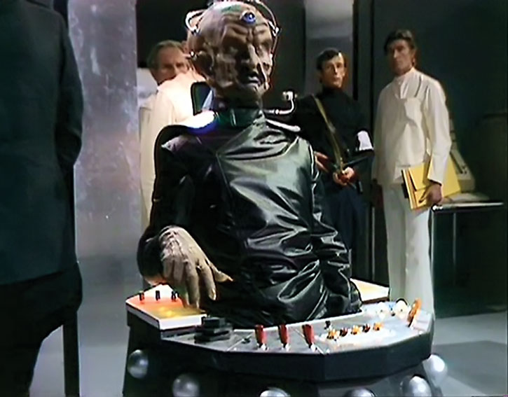 Davros amidst human scientists and guards