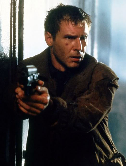 Deckard (Harrison Ford in Blade Runner) pointing his pistol