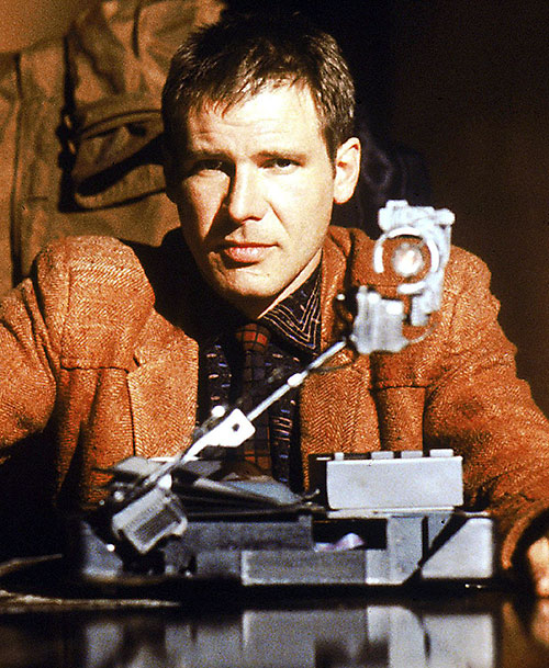 Deckard (Harrison Ford in Blade Runner) with his test machine