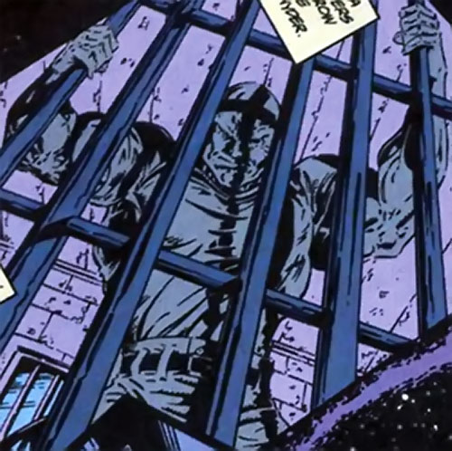 Devastator of the Cadre (JLA enemy) (DC Comics) behind bars