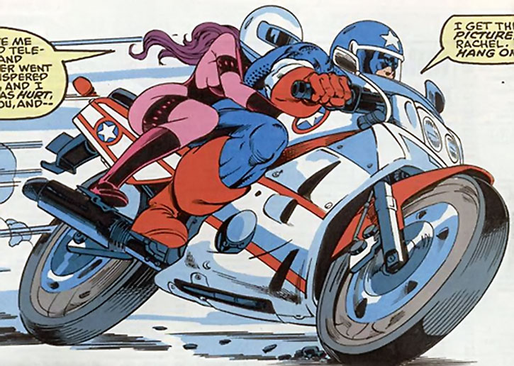 Diamondback (Rachel Leighton) rides with Captain America on his motorbike