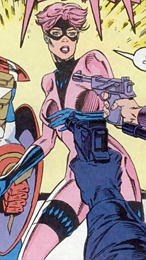 Diamondback (Captain America) (Marvel Comics) with short pink hair threatened by pistols