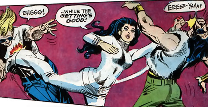 Diana Prince (Wonder Woman) takes out two thugs
