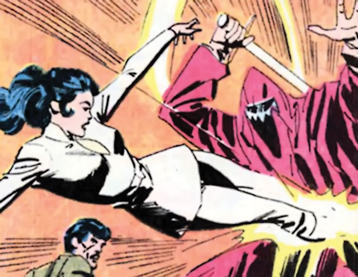 Diana Prince (Wonder Woman) dives onto a cultist