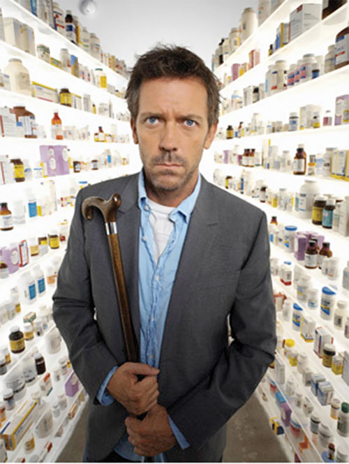 Doctor Gregory House (Hugh Laurie) among drugs shelves