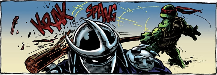 Donatello breaks his staff on the Shredder's helmet