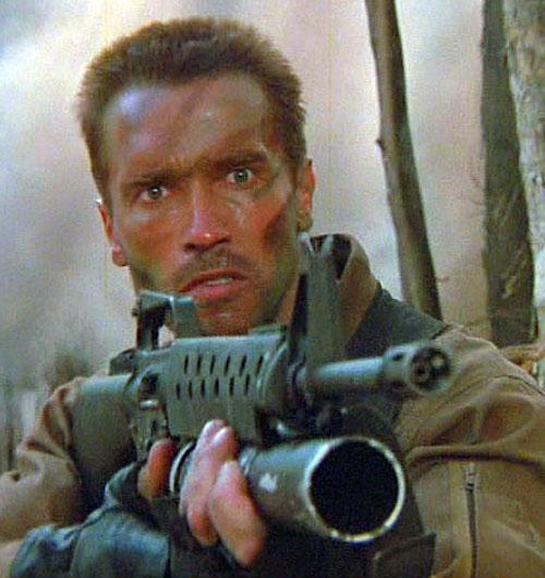 Dutch Schaeffer (Arnold Schwarzenegger in Predator) aiming an assault rifle