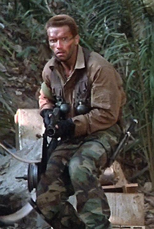 Dutch Schaeffer (Arnold Schwarzenegger in Predator) advancing with a rifle