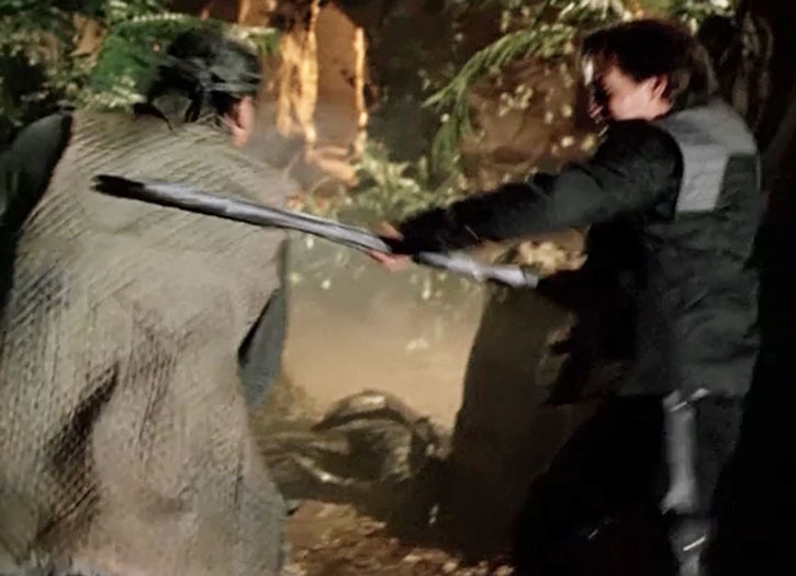 Dylan Hunt (Kevin Sorbo) fighting with a staff