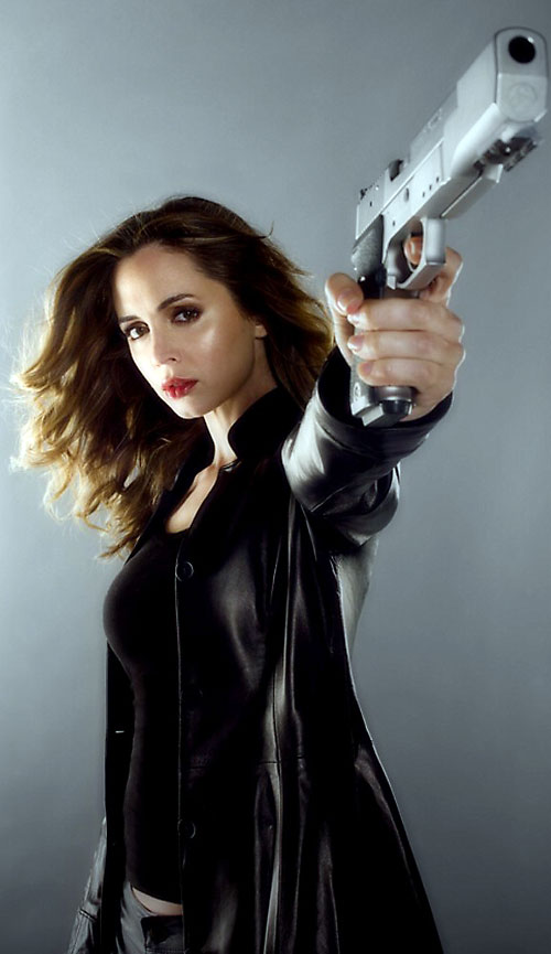 Echo (Eliza Dushku in Dollhouse) in a black leather jacket pointing a gun