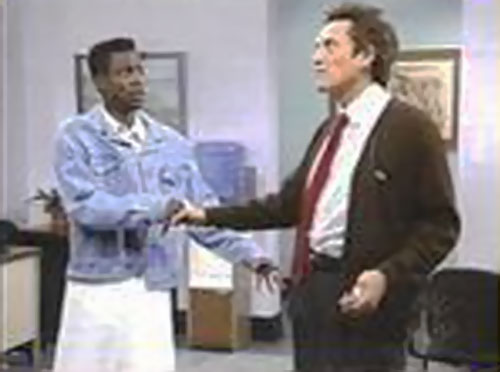 Christopher Walken as Ed Glosser the trivial psychic (SNL) shaking a man's hand