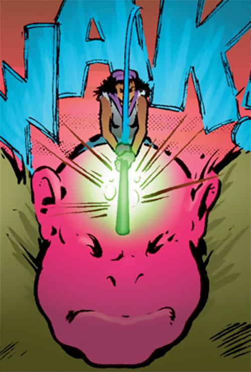 Edsel (Matt Wagner's Mage comics) hitting the ogre's head with her bat