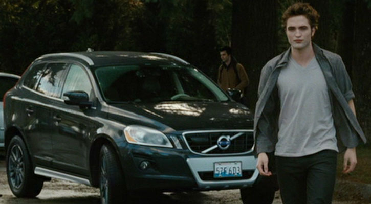 Edward Cullen (Robert Pattinson) walks in front of a product placement