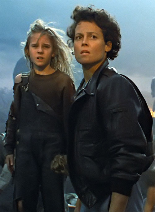 Ellen Ripley (Sigourney Weaver in Alien movies) in a leather jacket, with Newt