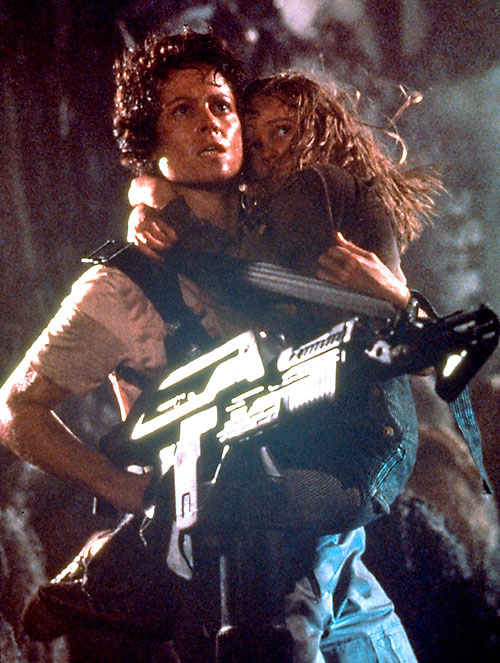 Ellen Ripley (Sigourney Weaver in Alien movies) carrying Newt and a pulse rifle