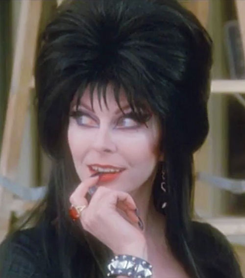 Elvira Mistress of the dark (Cassandra Peterson) acting coy