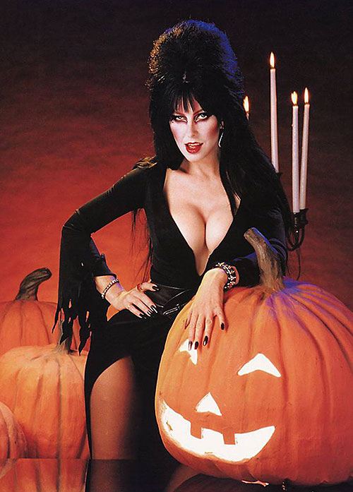 Elvira Mistress of the dark (Cassandra Peterson) with Halloween pumpkins