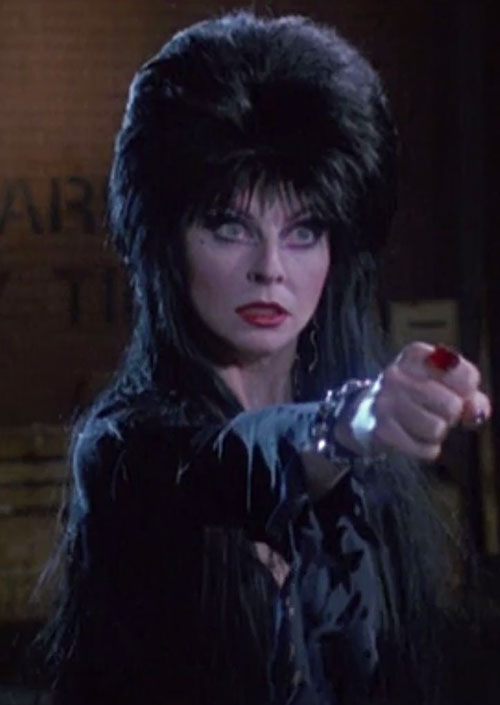 Elvira Mistress of the dark (Cassandra Peterson) fist with red ring