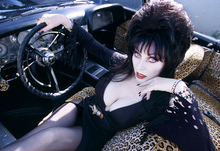 Elvira at the wheel of her car