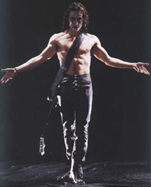 Eric Draven (Brandon Lee in the Crow) bare-chested with a  guitar