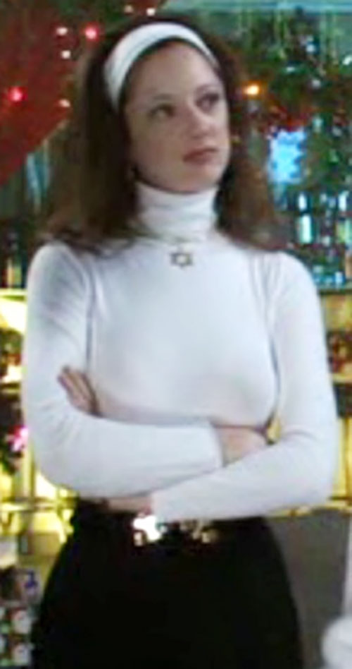 Esther Bloomenbergensteinenthal (Judy Greer in The Hebrew Hammer) with a white turtleneck and headband