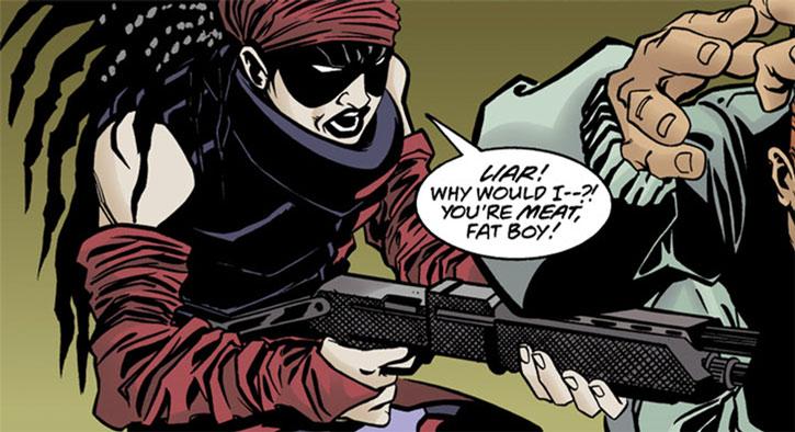 Ezra pointing her shotgun