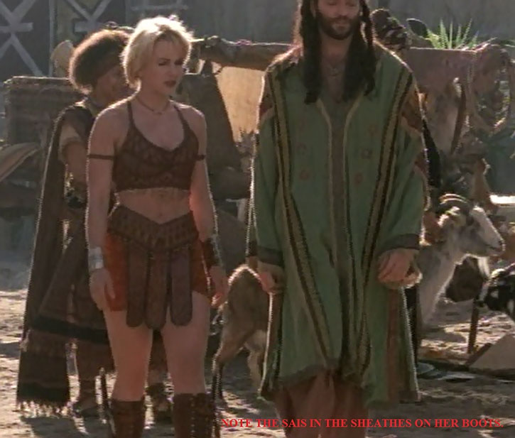 Gabrielle (Renee O'Connor) with sai sheathed in her boots