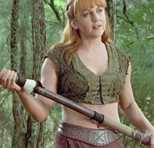 Gabrielle (Renee O'Connor in Xena) early on with a staff