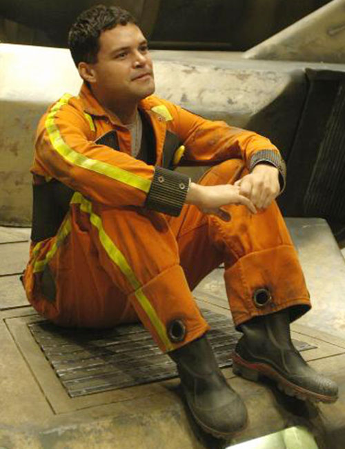 Chief Galen Tyrol (Aaron Douglas in Battlestar Galactica) in an orange jumpsuit