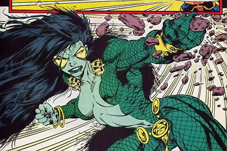 Gamora punches a thrown rock into gravel