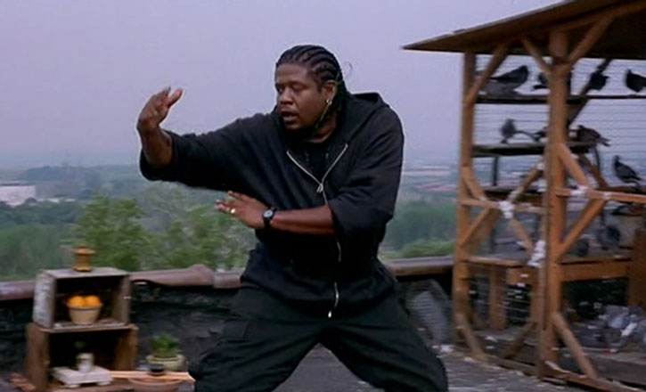 Ghost Dog (Forest Whitaker) practices the martial arts next to a pigeon coop