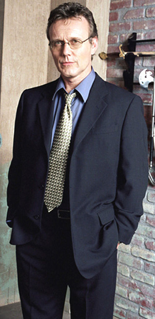 Giles (Anthony Head in Buffy) in a dark blue suit