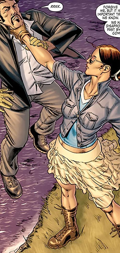 Giuana (Secret 6 enemy) (DC Comics) holding Deadshot over a cliff's edge