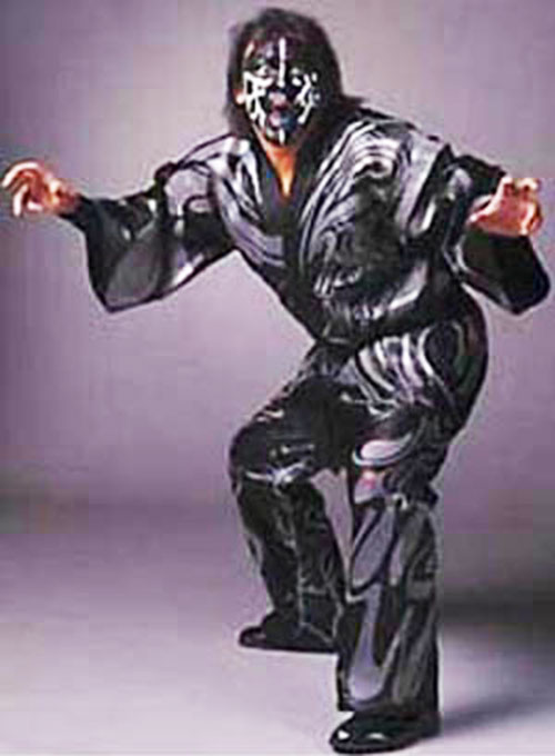 The Great Muta in a grey outfit