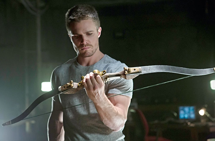 Green Arrow (Stephen Amell) with his weapon