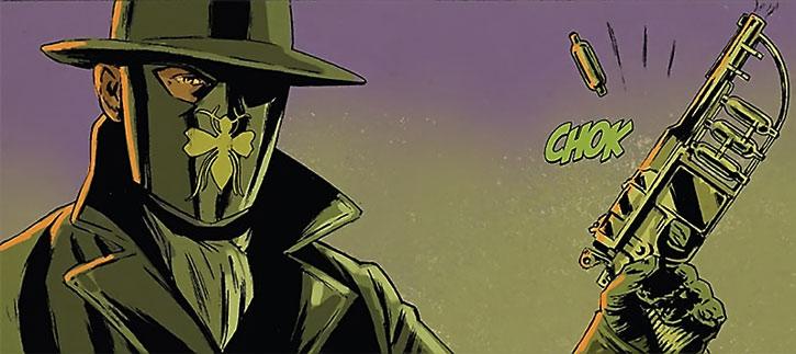 The Green Hornet (Britt Reid) reloads his special pistol